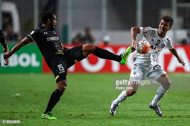 Marcos Rocha of Atletico MG and Beausejour of Colo Colo battle for the ball during a match between Atletico MG and Colo Colo as part of Copa...