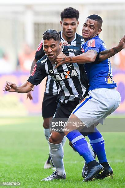Marcos Rocha of Atletico MG and Bryan of Cruzeiro battle for the ball during a match between Atletico MG and Cruzeiro as part of Brasileirao Series A...