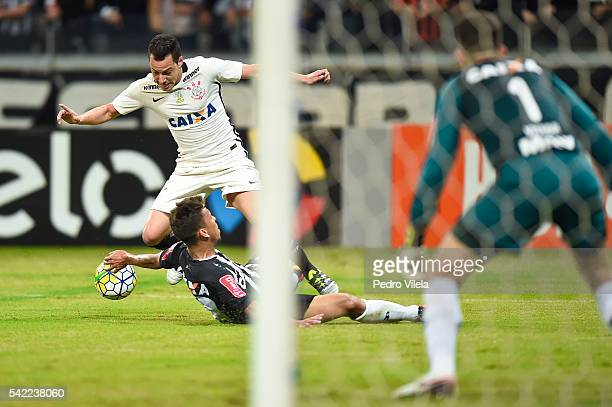 Marcos Rocha of Atletico MG and Rodriguinho of Corinthians battle for the ball during a match between Atletico MG and Corinthians as part of...