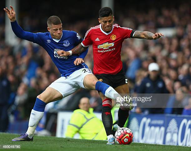 Marcos Roja of Manchester United and Ross Barkley of Everton compete for the ball during the Barclays Premier League match between Everton and...