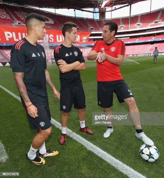 Marcos Rojo and Ander Herrera of Manchester United in action during a training session ahead of their UEFA Champions League match against Benfica on...