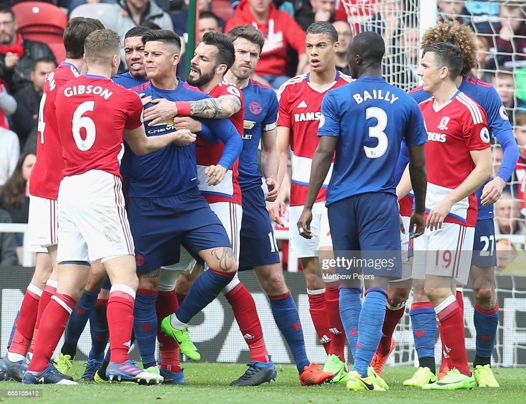 Marcos Rojo and Chris Smalling of Manchester United are calmed down by Ben Gibson of Middlesbrough after Eric Bailly clashed with Rudy Gestede during the Premier League match between Middlesbrough and Manchester United at Riverside Stadium on March 19, 2017 in Middlesbrough, England.