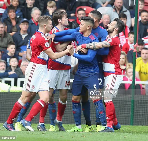 Marcos Rojo and Chris Smalling of Manchester United are calmed down by Ben Gibson of Middlesbrough after Eric Bailly clashed with Rudy Gestede during...
