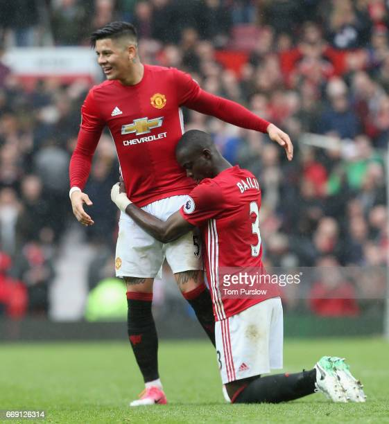 Marcos Rojo and Eric Bailly of Manchester United celebrate after the Premier League match between Manchester United and Chelsea at Old Trafford on...