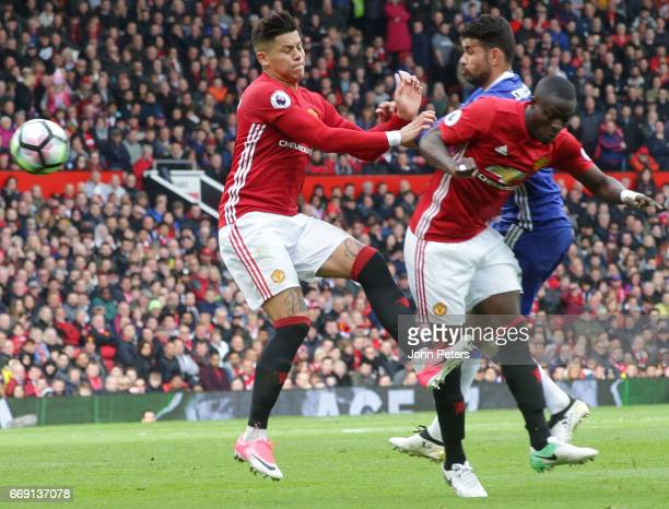 Marcos Rojo and Eric Bailly of Manchester United in action with Diego Costa of Chelsea during the Premier League match between Manchester United and...