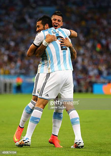 Marcos Rojo and Ezequiel Garay of Argentina celebrate their team's first goal during the 2014 FIFA World Cup Brazil Group F match between Argentina...