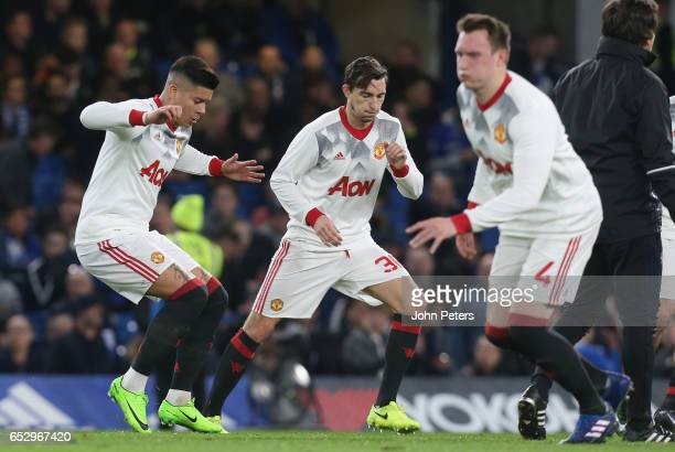 Marcos Rojo and Matteo Darmian of Manchester United warm up ahead of the Emirates FA Cup QuarterFinal match between Chelsea and Manchester United at...
