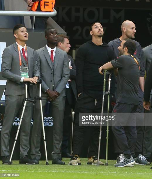 Marcos Rojo Eric Bailly and Zlatan Ibrahimovic of Manchester United watch the warmup from the sidelines ahead of the UEFA Europa League Final match...