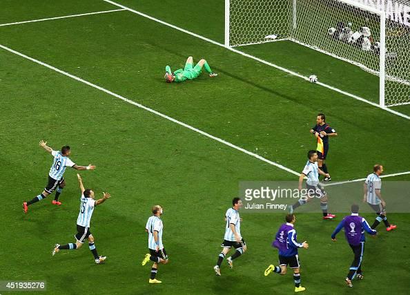 Marcos Rojo Martin Demichelis Pablo Zabaleta Lionel Messi Sergio Aguero and Rodrigo Palacio of Argentina celebrate defeating the Netherlands in a...