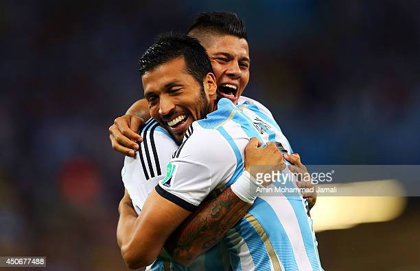 Marcos Rojo of Argentina and Ezequiel Garay of Argentina celebrate their team's first goal during the 2014 FIFA World Cup Brazil Group F match...
