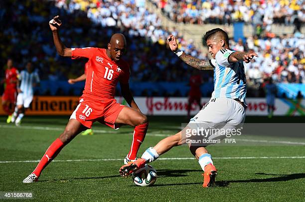 Marcos Rojo of Argentina and Gelson Fernandes of Switzerland compete for the ball during the 2014 FIFA World Cup Brazil Round of 16 match between...