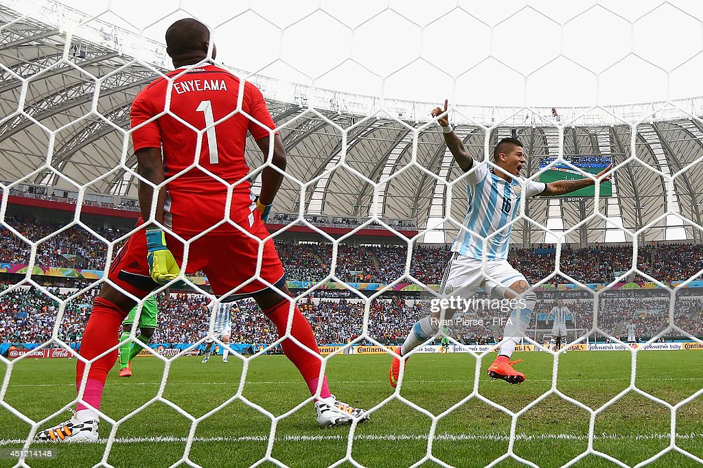 <a gi-track='captionPersonalityLinkClicked' href=/galleries/search?phrase=Marcos+Rojo&family=editorial&specificpeople=6740047 ng-click='$event.stopPropagation()'>Marcos Rojo</a> of Argentina celebrates after scoring his team's third goal past <a gi-track='captionPersonalityLinkClicked' href=/galleries/search?phrase=Vincent+Enyeama&family=editorial&specificpeople=831392 ng-click='$event.stopPropagation()'>Vincent Enyeama</a> of Nigeria during the 2014 FIFA World Cup Brazil Group F match between Nigeria and Argentina at Estadio Beira-Rio on June 25, 2014 in Porto Alegre, Brazil.