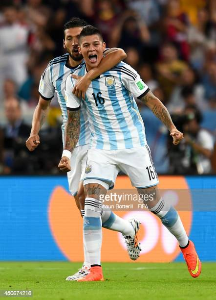 Marcos Rojo of Argentina celebrates after Sead Kolasinac of Bosnia and Herzegovina scored an own goal during the 2014 FIFA World Cup Brazil Group F...