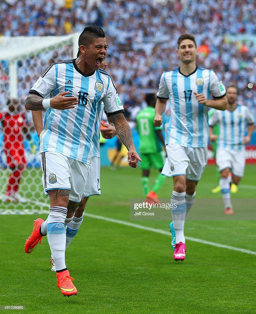 <a gi-track='captionPersonalityLinkClicked' href=/galleries/search?phrase=Marcos+Rojo&family=editorial&specificpeople=6740047 ng-click='$event.stopPropagation()'>Marcos Rojo</a> of Argentina celebrates scoring his team's third goal during the 2014 FIFA World Cup Brazil Group F match between Nigeria and Argentina at Estadio Beira-Rio on June 25, 2014 in Porto Alegre, Brazil.