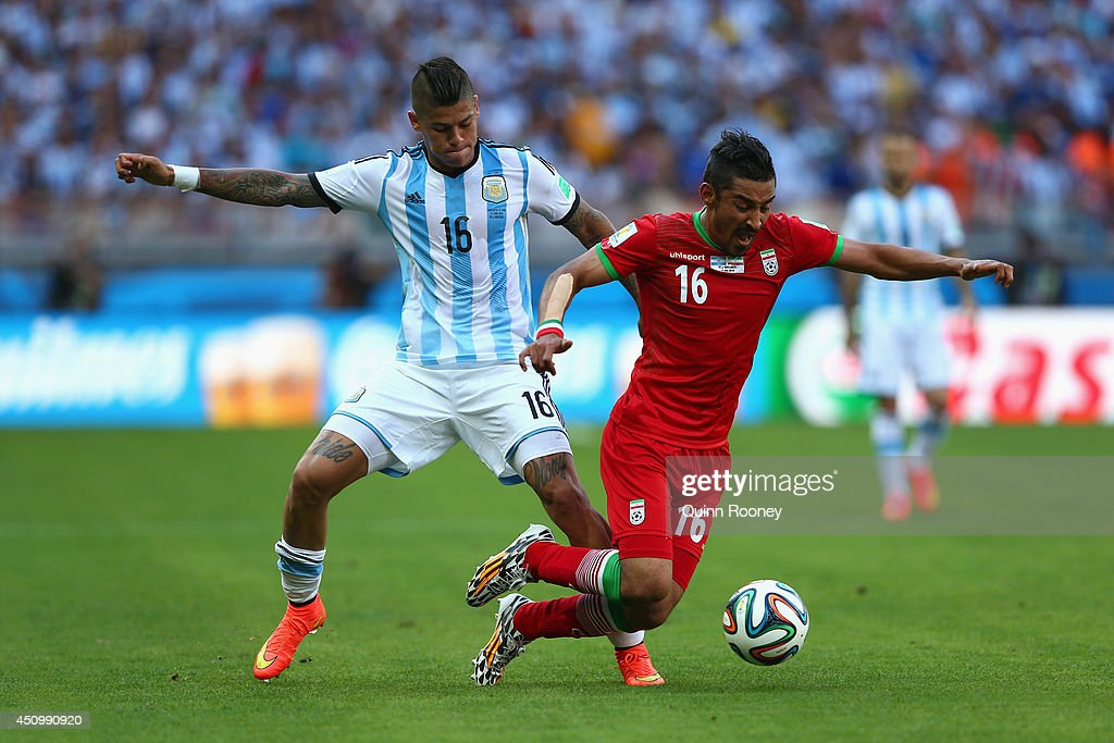<a gi-track='captionPersonalityLinkClicked' href=/galleries/search?phrase=Marcos+Rojo&family=editorial&specificpeople=6740047 ng-click='$event.stopPropagation()'>Marcos Rojo</a> of Argentina challenges <a gi-track='captionPersonalityLinkClicked' href=/galleries/search?phrase=Reza+Ghoochannejhad&family=editorial&specificpeople=9861610 ng-click='$event.stopPropagation()'>Reza Ghoochannejhad</a> of Iran during the 2014 FIFA World Cup Brazil Group F match between Argentina and Iran at Estadio Mineirao on June 21, 2014 in Belo Horizonte, Brazil.
