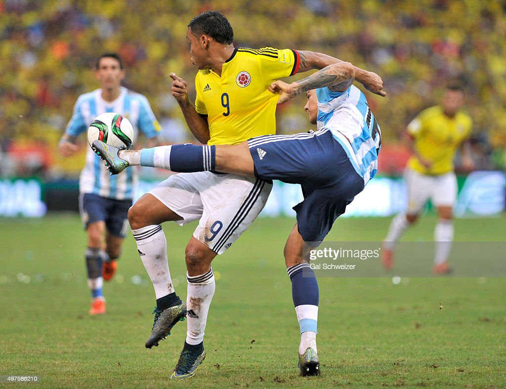 Marcos Rojo (R) of Argentina struggles for the ball with Fernando Muriel (L) of Colombia during a match between Colombia and Argentina as part of FIFA 2018 World Cup Qualifiers at Metropolitano Stadium on November 17, 2015 in Barranquilla, Colombia.