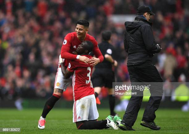 Marcos Rojo of Manchester United and Eric Bailly of Manchester United celebrate together after the Premier League match between Manchester United and...