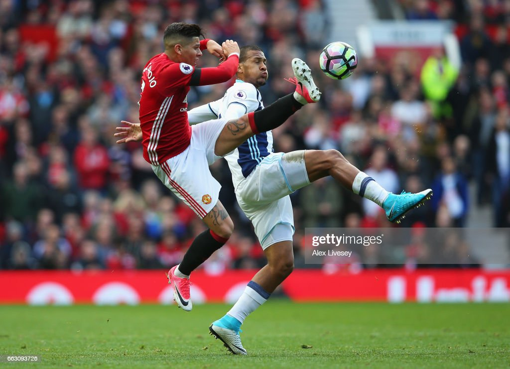 Marcos Rojo of Manchester United (L) and Jose Salomon Rondon of West Bromwich Albion (R) battle for possession during the Premier League match between Manchester United and West Bromwich Albion at Old Trafford on April 1, 2017 in Manchester, England.