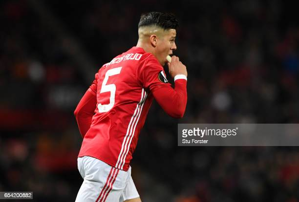 Marcos Rojo of Manchester United eats a banana during the UEFA Europa League Round of 16 second leg match between Manchester United and FK Rostov at...