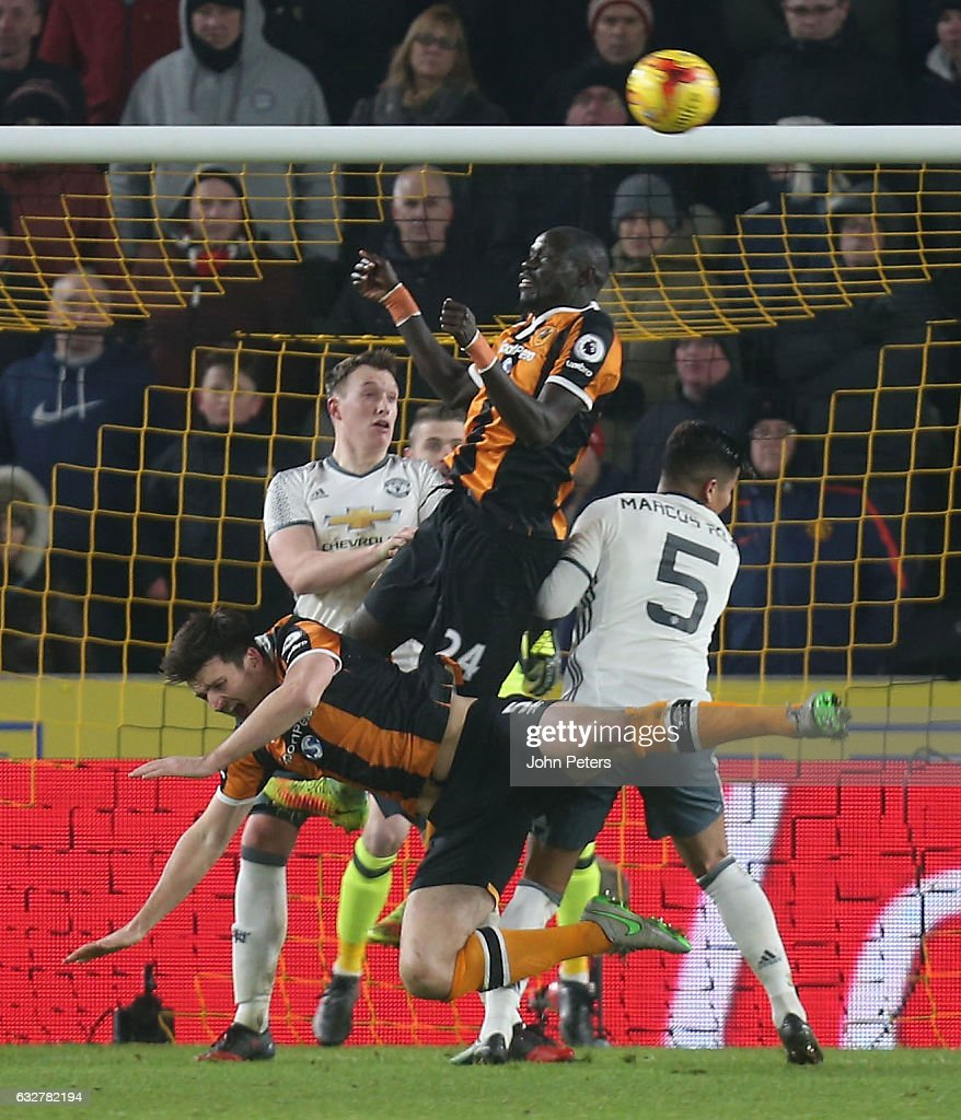 Marcos Rojo of Manchester United fouls Harry McGuire of Hull City to give away a penalty during the EFL Cup Semi-Final second leg match between Hull City and Manchester United at KCOM Stadium on January 26, 2017 in Hull, England.