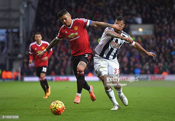 Marcos Rojo of Manchester United holds off Salomon Rondon of West Bromwich Albion during the Barclays Premier League match between West Bromwich...