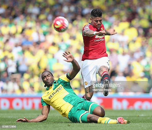Marcos Rojo of Manchester United in action with Cameron Jerome of Norwich City during the Barclays Premier League match between Norwich City and...
