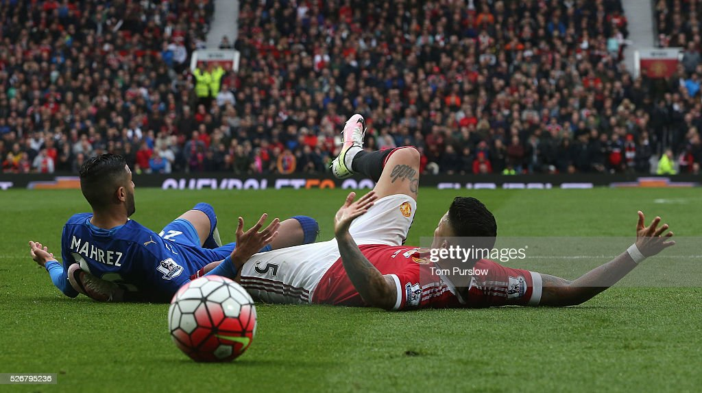 <a gi-track='captionPersonalityLinkClicked' href=/galleries/search?phrase=Marcos+Rojo&family=editorial&specificpeople=6740047 ng-click='$event.stopPropagation()'>Marcos Rojo</a> of Manchester United in action with <a gi-track='captionPersonalityLinkClicked' href=/galleries/search?phrase=Riyad+Mahrez&family=editorial&specificpeople=9166027 ng-click='$event.stopPropagation()'>Riyad Mahrez</a> of Leicester City during the Barclays Premier League match between Manchester United and Leicester City at Old Trafford on May 1, 2016 in Manchester, England.