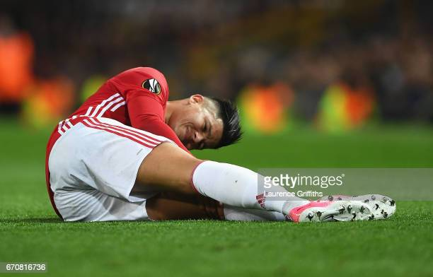 Marcos Rojo of Manchester United is injured during the UEFA Europa League quarter final second leg match between Manchester United and RSC Anderlecht...
