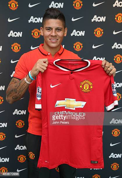 Marcos Rojo of Manchester United poses after signing for the club at Aon Training Complex on August 20 2014 in Manchester England