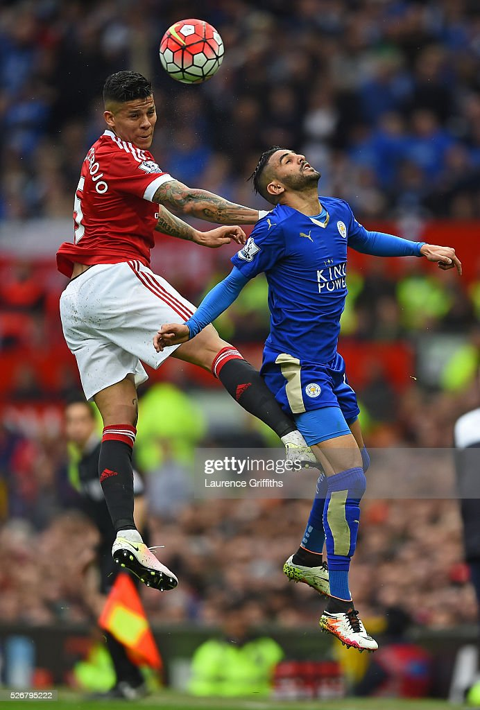 <a gi-track='captionPersonalityLinkClicked' href=/galleries/search?phrase=Marcos+Rojo&family=editorial&specificpeople=6740047 ng-click='$event.stopPropagation()'>Marcos Rojo</a> of Manchester United wins a header with <a gi-track='captionPersonalityLinkClicked' href=/galleries/search?phrase=Riyad+Mahrez&family=editorial&specificpeople=9166027 ng-click='$event.stopPropagation()'>Riyad Mahrez</a> of Leicester City during the Barclays Premier League match between Manchester United and Leicester City at Old Trafford on May 1, 2016 in Manchester, England.