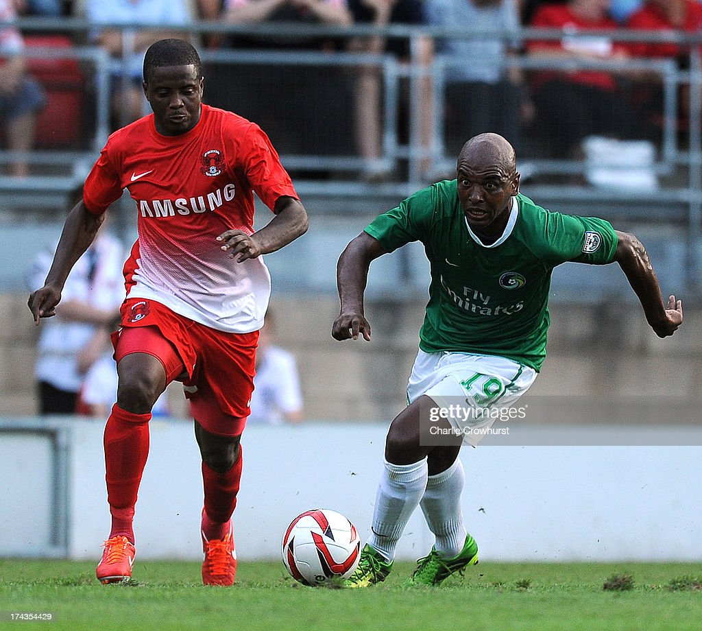 <a gi-track='captionPersonalityLinkClicked' href=/galleries/search?phrase=Marcos+Senna&family=editorial&specificpeople=490904 ng-click='$event.stopPropagation()'>Marcos Senna</a> of New York Cosmos looks to get away from Orient's <a gi-track='captionPersonalityLinkClicked' href=/galleries/search?phrase=Kevin+Lisbie&family=editorial&specificpeople=226902 ng-click='$event.stopPropagation()'>Kevin Lisbie</a> during the pre season friendly match between Leyton Orient and New York Cosmos at The Matchroom Stadium on July 24, 2013 in London, England,