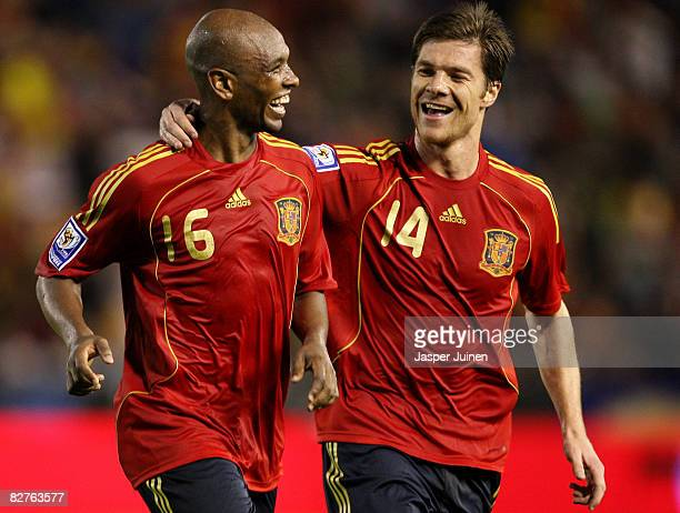 Marcos Senna of Spain celebrates his goal with his teammate Xabier Alonso during the FIFA2010 World Cup Qualifying match between Spain and Armenia at...