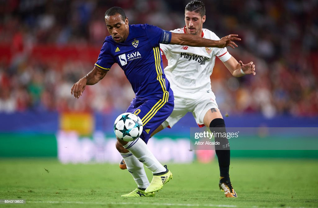 Marcos Tavares of NK Maribor (L) competes for the ball with Sergio Escudero of Sevilla FC (R) during the UEFA Champions League match between Sevilla FC and NK Maribor at Estadio Ramon Sanchez Pizjuan on September 26, 2017 in Seville, Spain.