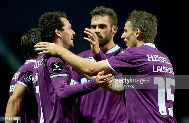 Marcos Urena of FC Midtjylland celebrates with team mate Jesper Lauridsen and Jim Larsen after scoring their first goal during the Danish Superliga...