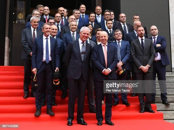 MarcoTronchetti Provera CEO of Pirelli and Raffaele Jerusalmi CEO of Borsa Italiana and staff pose during the ceremony of the return of Pirelli to...