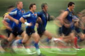 France's rugby union national team players run as they attend a training session 27 July 2007 in Marcoussis outside Paris France will host the Rugby...