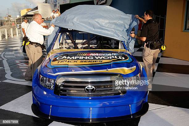 Marcuis Lemonis Chairman CEO of Camping World and Wayne Auton Director of Nascar Truck Series unvails the new logo for the Truck Series for 2009...