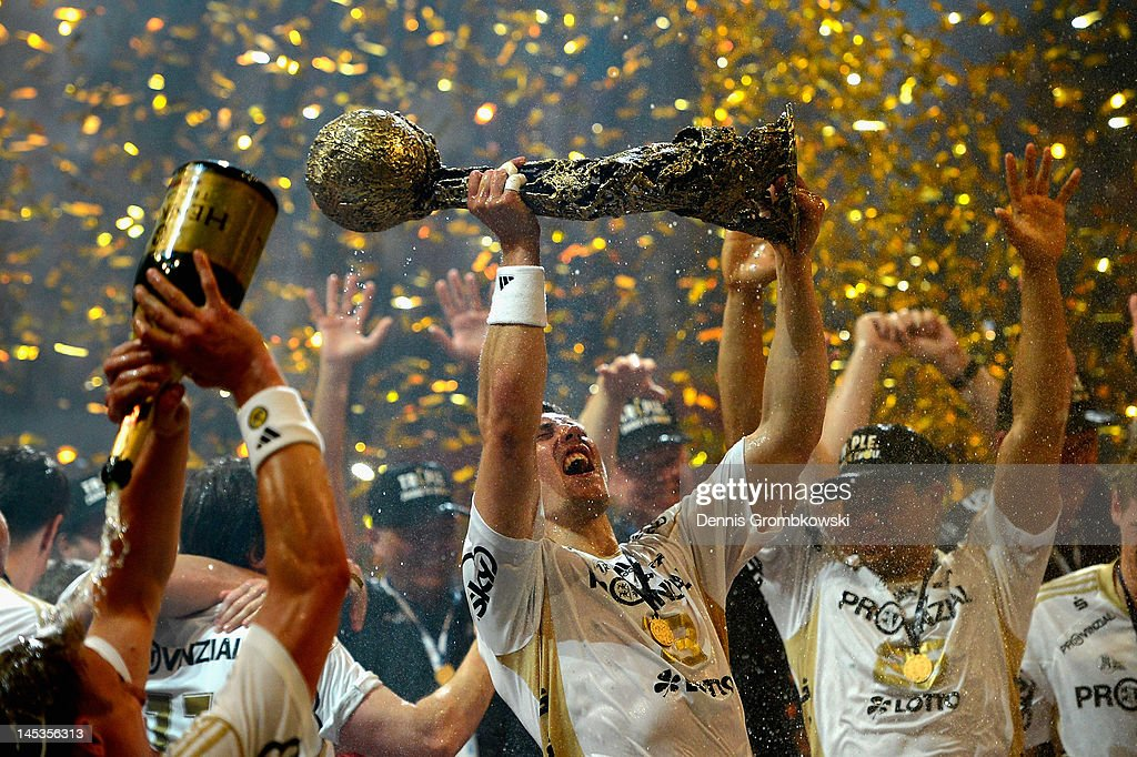 <a gi-track='captionPersonalityLinkClicked' href=/galleries/search?phrase=Marcus+Ahlm&family=editorial&specificpeople=626527 ng-click='$event.stopPropagation()'>Marcus Ahlm</a> of Kiel lifts the trophy after the EHF Final Four final match between THW Kiel and BM Atletico Madrid at Lanxess Arena on May 27, 2012 in Cologne, Germany.