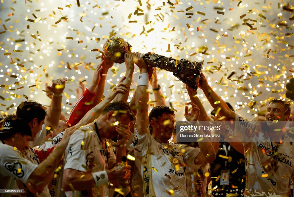 Marcus Ahlm of Kiel lifts the trophy after the EHF Final Four final match between THW Kiel and BM Atletico Madrid at Lanxess Arena on May 27, 2012 in Cologne, Germany.