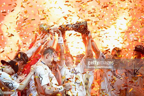 Marcus Ahlm of Kiel lifts the trophy after the EHF Final Four final match between THW Kiel and BM Atletico Madrid at Lanxess Arena on May 27 2012 in...