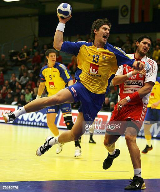 Marcus Ahlm of Sweden in action with Laszlo Nagy of Hungary during the Men's Handball European Championship main round Group II match between Hungary...