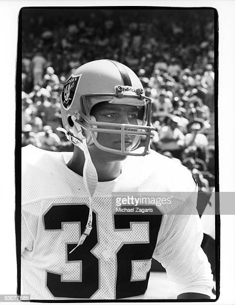 Marcus Allen of the Los Angeles Raiders looks on from the sidelines during a September 1982 game