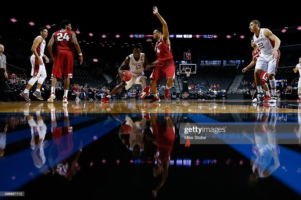 Marcus Allen of the Stanford Cardinal drives to the basket against Jabril Durham of the Arkansas Razorbacks at Barclays Center on November 27 2015 in...