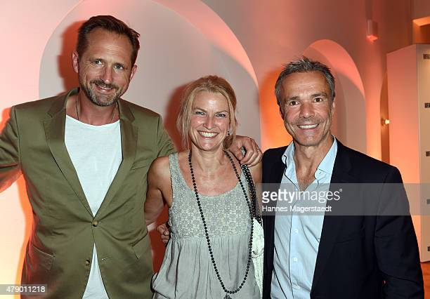 Marcus Ammon Petra Hinteneder and Hannes Jaenicke attend the UFA FICTION Reception during the Munich Film Festival at Cafe Reitschule on June 29 2015...