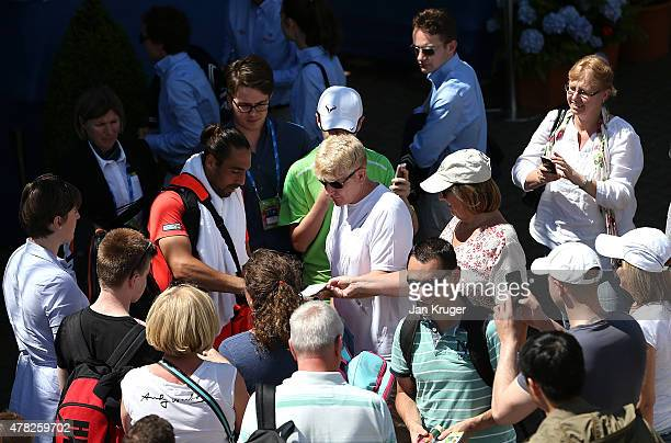Marcus Baghdatis of Cyprus signs autographs after his match against Alexander Zverev of Germany on day four of the Aegon Open Nottingham at...