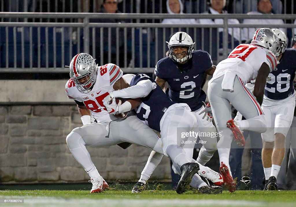 Marcus Baugh #85 of the Ohio State Buckeyes catches a 26 yard pass for a touchdown in the first half during the game against the Penn State Nittany Lions on October 22, 2016 at Beaver Stadium in State College, Pennsylvania.
