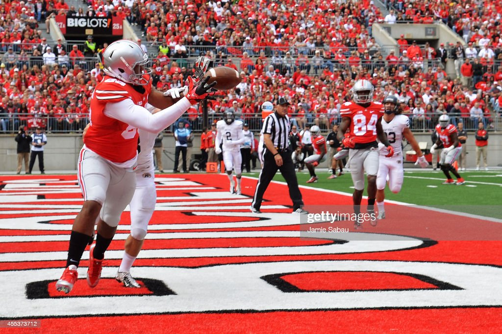 Marcus Baugh of the Ohio State Buckeyes catches a twoyard touchdown pass in front of Nate Holley of the Kent State Golden Flashes in the second...