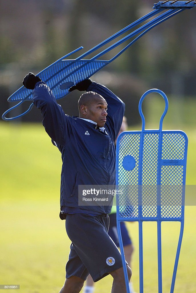 Marcus Bent of Leicester City moves the traing ground dummies during the teams training session at the Blevoir Drive training ground on February 26, 2004 in Leicester, England.