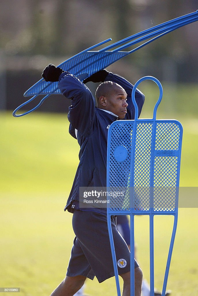 Marcus Bent of Leicester City moves the training ground dummies during the teams training session at the Blevoir Drive training ground on February 26, 2004 in Leicester, England.