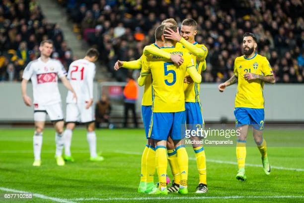 Marcus Berg Ludwig Augustinsson Mikael Lustig and Jimmy Durmaz of Sweden celebrates scoring the 30 goal during the FIFA 2018 World Cup Qualifier...
